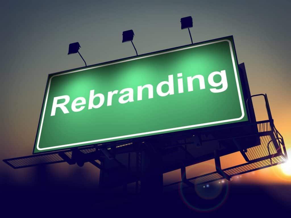 Rebranding - Green Billboard on the Rising Sun Background.